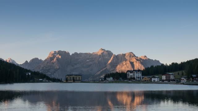 Sunrise on the mountain and reflection lake , Misurina lake