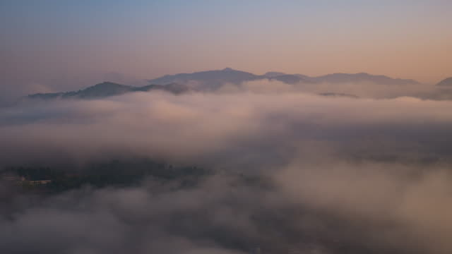 sunrise on the mountain view point and moving of mist , 4k(uhd) , time-lapse - marin stock videos & royalty-free footage
