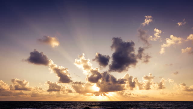 sunrise on the ocean timelapse, clouds in motion - horizon over water stock videos & royalty-free footage