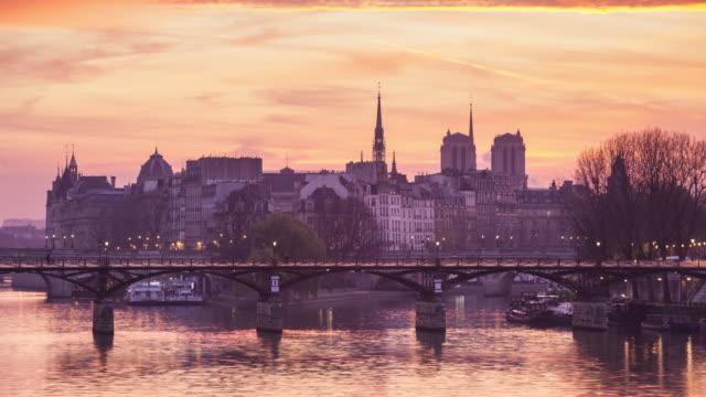 sunrise on the river seine and pont des arts, paris. - notre dame de paris stock videos and b-roll footage