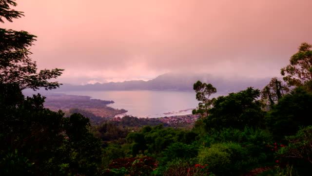 sunrise on the volcano batur overlooking lake batur, bali, indonesia - kalimantan stock videos and b-roll footage