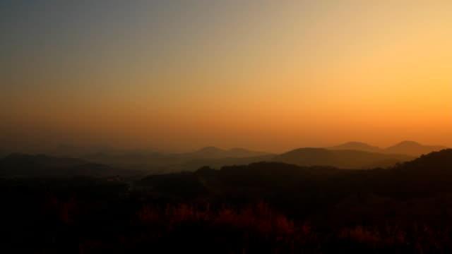 Sunrise or sunset over mountain.