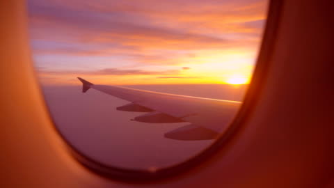 sunrise or sunset view aircraft wing from an airplane window - focus on background stock videos & royalty-free footage