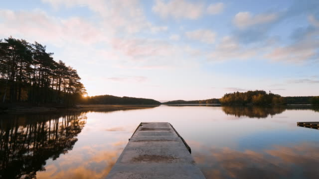 sunrise over a lake in autumn - jetty stock videos & royalty-free footage