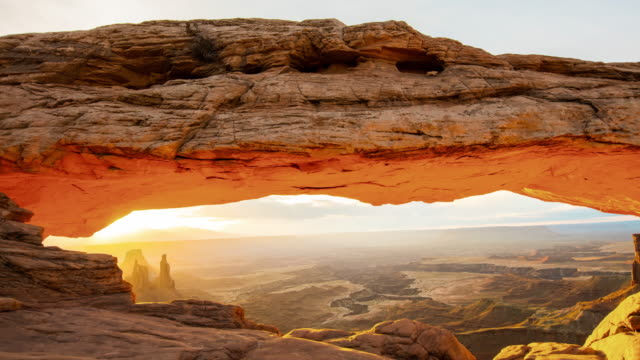 t/l 8k sunrise over a sandstone arch - natural arch stock videos & royalty-free footage