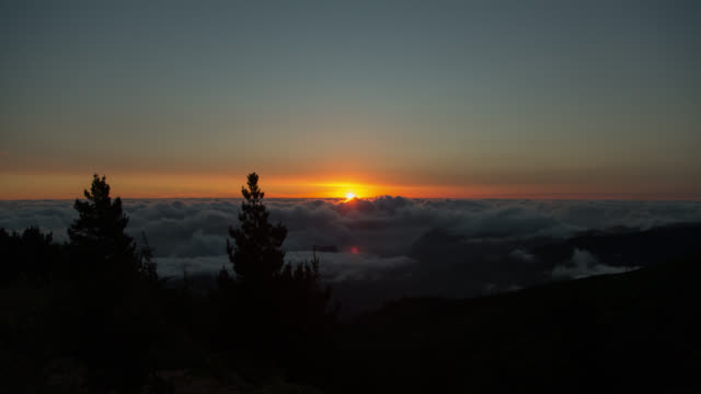 Sunrise over a sea of clouds in Madeira, Portugal