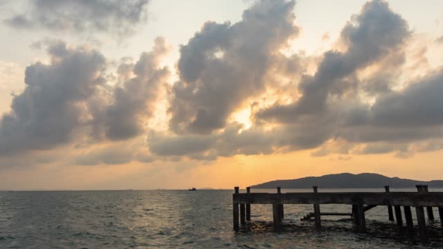 sunrise over an ocean with abandon jetty, time lapse video - jetty stock videos & royalty-free footage