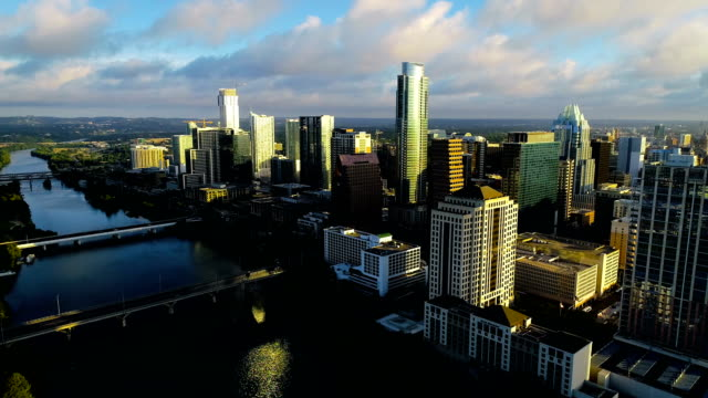 sunrise over austin texas puffy white clouds and blue waters of lady bird lake - austin white stock videos & royalty-free footage
