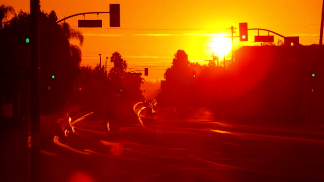 sunrise over busy street - road signal stock videos & royalty-free footage