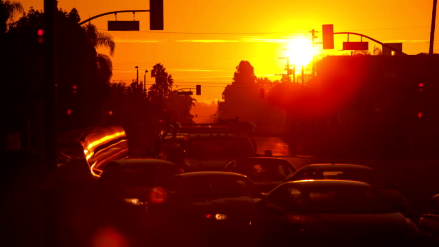 sunrise over busy street - sunrise dawn stock videos & royalty-free footage