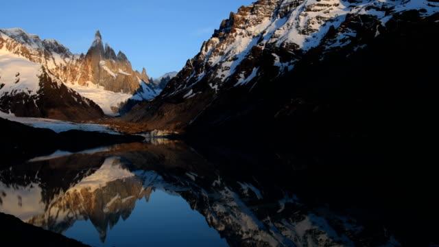 sunrise over cerro torre in argentina - argentina america del sud video stock e b–roll