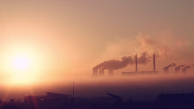 sunrise over coal-fired powerstation in south africa - provinz mpumalanga stock-videos und b-roll-filmmaterial