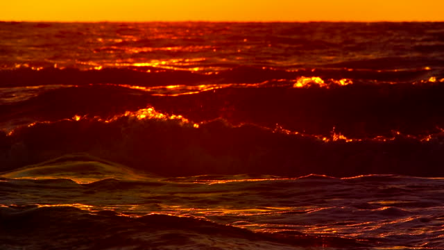 sunrise over crashing waves in slow motion - saturated colour stock videos & royalty-free footage