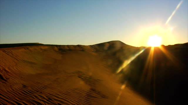 ws t/l sunrise over dunes, dubai, united arab emirates - sand dune stock videos and b-roll footage