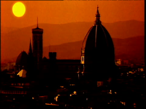 sunrise over duomo, light covers cityscape - morning stock videos & royalty-free footage