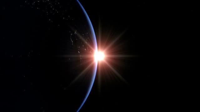 sunrise over earth - 軌道を回る点の映像素材/bロール