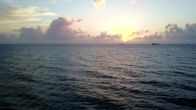 Sunrise over Fort Lauderdale, Florida, two ships on the horizon