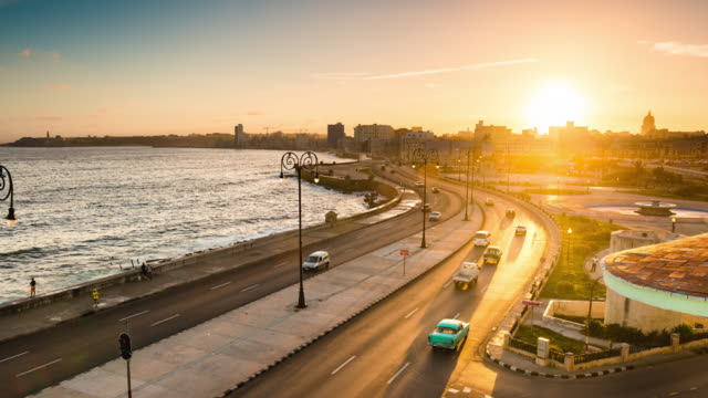 sunrise over havana's malecon cuba - havana stock videos & royalty-free footage