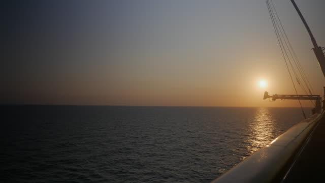 Sunrise over horizon on the sea