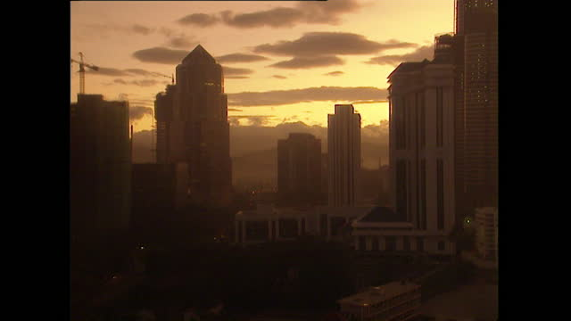 ws sunrise over kuala lumpur cityscape and skyscrapers; 1996 - 1996 stock videos & royalty-free footage