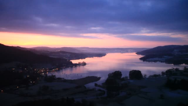 sunrise over lake windermere at ambleside from todd crag, lake district, uk. - frozen stock videos & royalty-free footage