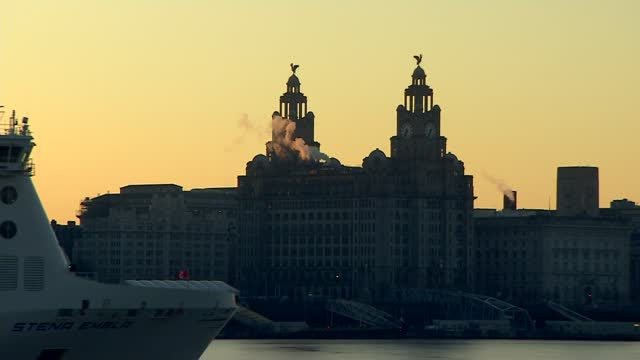 sunrise over liverpool waterfront buildings; england: merseyside: liverpool: ext / dawn sunrise over liverpool waterfront buildings - good shots -... - mersey ferry stock videos & royalty-free footage