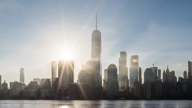 t/l ms zo sunrise over lower manhattan / new york city, usa - world trade center manhattan video stock e b–roll