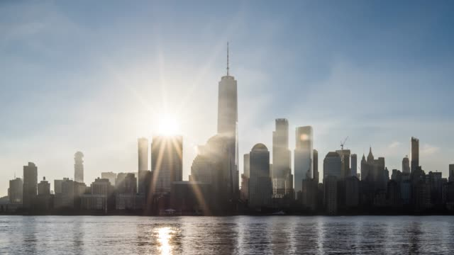 t/l ms zi sunrise over lower manhattan / new york city, usa - hope stock videos & royalty-free footage