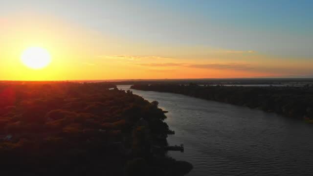 sunrise over lower zambezi river - africa - zambia stock videos & royalty-free footage