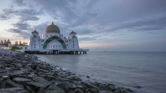 sunrise over malacca straits floating mosque (masjid selat melaka) - malacca stock videos and b-roll footage
