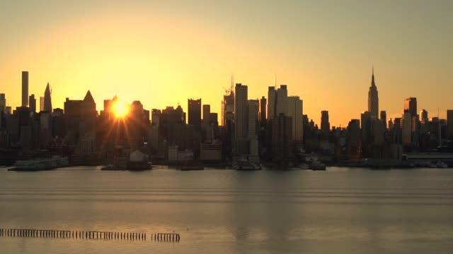 sunrise over midtown manhattan / new york city, usa - manhattan stock videos & royalty-free footage