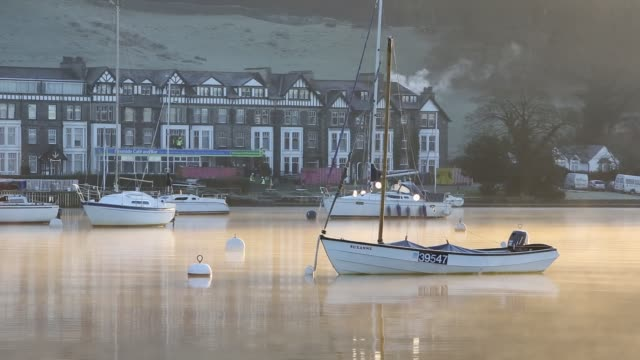 sunrise over mist on lake windermere, at ambleside, lake district, uk. - water surface stock videos & royalty-free footage