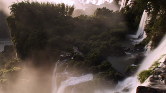 tl sunrise over misty iguazu falls, argentina - south america stock videos & royalty-free footage