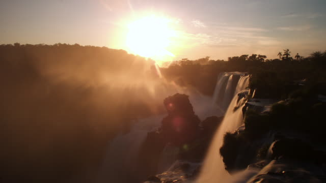 tl sunrise over misty iguazu falls, argentina - sunrise dawn stock videos & royalty-free footage