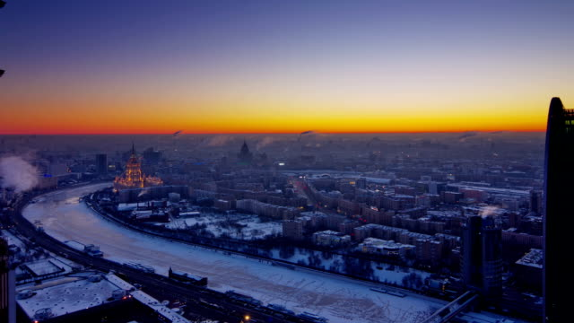 tl sunrise over moscow city. winter / russia - moscow russia stock videos & royalty-free footage