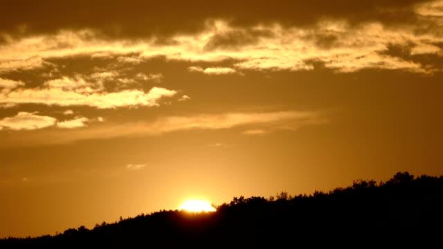 Sunrise over mountain timelapse