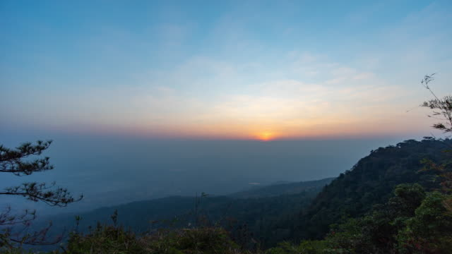 sunrise over mountain with fog cloud, dawn to day time lapse video - dawn to day stock videos & royalty-free footage