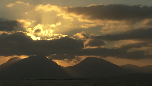 ws sunrise over mountains of the paps of jura in the hebrides on the west coast of scotland - hebrides stock videos & royalty-free footage