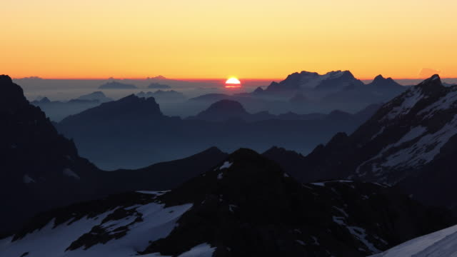 sunrise over mountains - mountain peak stock videos & royalty-free footage