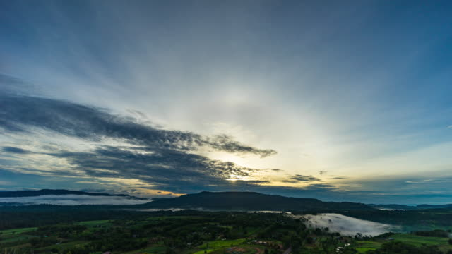 sunrise over mountains with flow of fog over the forest, dawn to day time lapse video - dawn to day stock videos & royalty-free footage