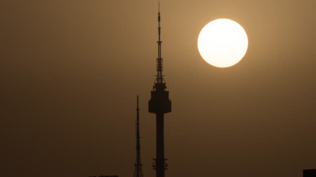 sunrise over n seoul tower / seoul, south korea - grove stock videos & royalty-free footage