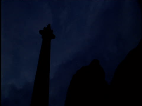 sunrise over nelson's column and lion statue - nelson's column stock videos and b-roll footage