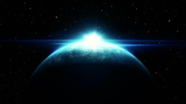 vídeos de stock e filmes b-roll de sunrise over planet from space with galaxy star - rasto de estrelas