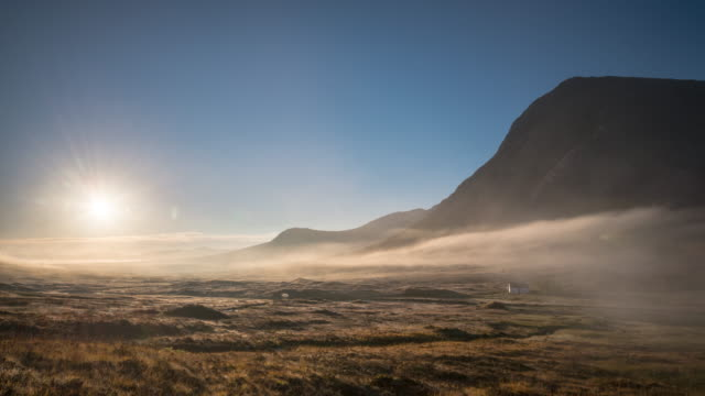 Sunrise over Rannoch moor with the silhouette of Buachaille Etive Mòr in the Highlands of Scotland