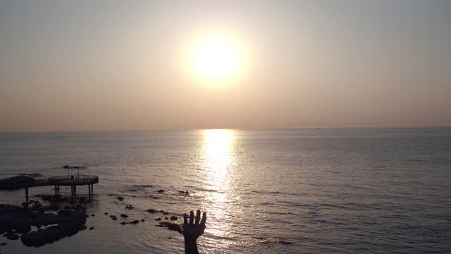 sunrise over sangsaeng's hand (hand of harmony) in homigot village / pohang-si, gyeongsangbuk-do, south korea - symbols of peace stock videos & royalty-free footage