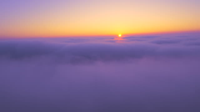 AERIAL Sunrise Over The Clouds
