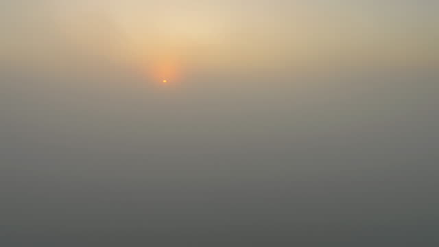 aerial sunrise over the clouds - multicopter stock videos & royalty-free footage