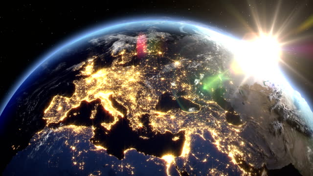 vídeos de stock e filmes b-roll de sunrise over the earth seen from space.close up of italy and europe zone.with night time and sunrise 4k. - imagem de satélite