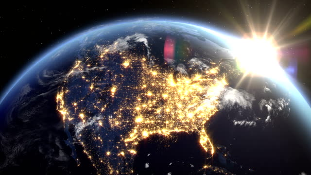 sunrise over the earth seen from space.close up of usa zone with night time and sunrise 4k. - stati uniti d'america video stock e b–roll