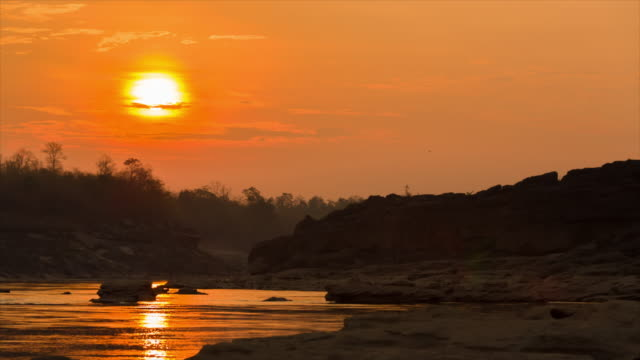 Zonsopgang boven de Mekong rivier